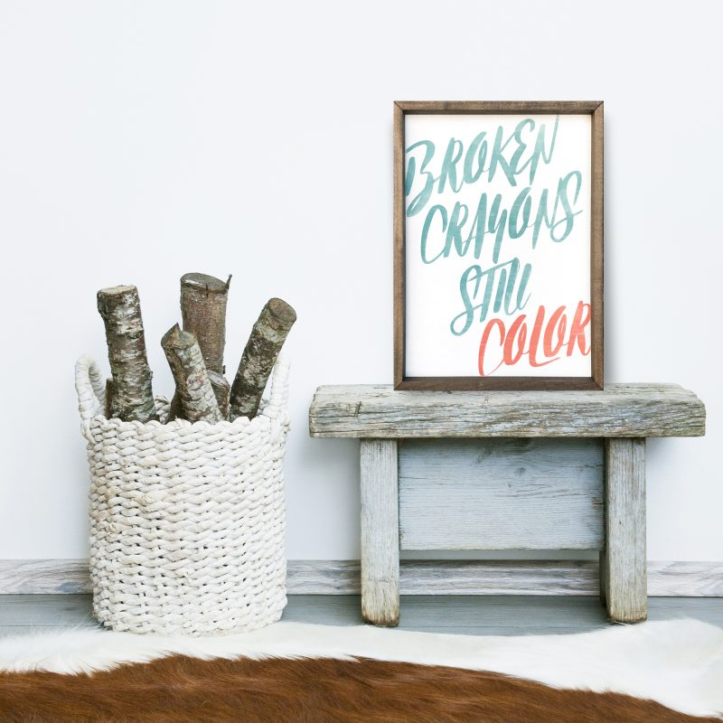 wooden frame YOU ARE AN ADVENTURE STORY. Hipster scandinavian style room interior. Busket with firewood and a cow rug on the floor